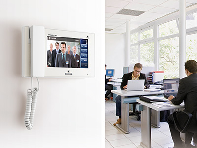 Intercom wall mounted in office for room to room communication